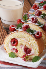 cake with fresh raspberries and milk on the table vertical