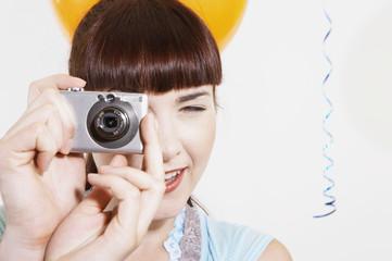 Close up of woman using digital camera