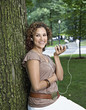 Hispanic woman listening to mp3 player outdoors