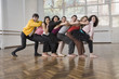 Hispanic dancers posing in dance studio