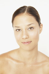 Portrait of Asian woman with bare shoulders