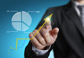 business man pointing at growth graph