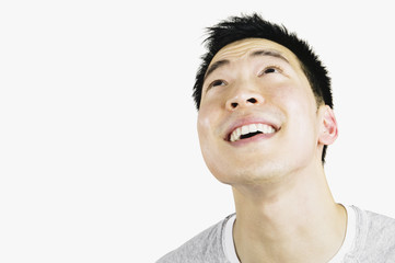 Portrait of Asian man looking up