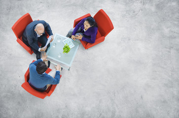 Business People Having a Discussion in an Industrial Building