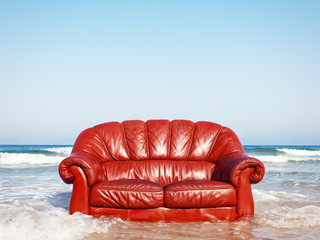 red vintage sofa in the sea
