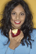 Portrait of Middle Eastern woman eating apple