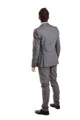 business man from the back - looking at something over a white