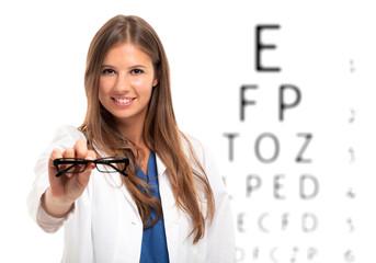 Oculist holding a pair of eyeglasses
