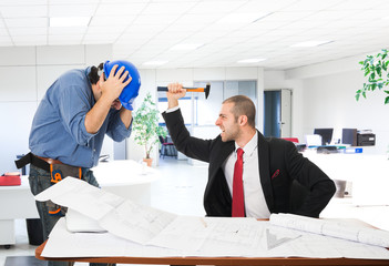 Angry boss attacking a worker