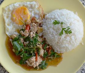thai cuisine,  basil  fried rice and fried egg.