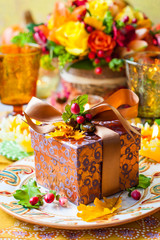 Gift box on festive table