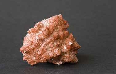 Quartz covered with a layer of red iron oxide. 5cm high.