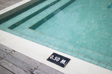 Swimming pool with steps and depth sign