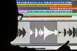 Leinwanddruck Bild - Man Editing Digital Audio on a Computer