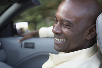 Portrait of African man in convertible car