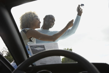 African couple fighting over car keys