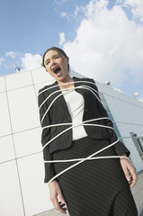 Businesswoman tied up and yelling