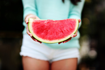Closeup portrait of a female hands holding watermelon