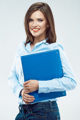 Business woman smiling. Standing against gray