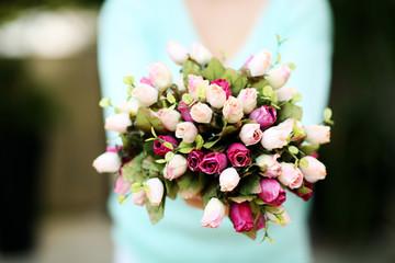 Closeup portrait of a female hands holding flowers