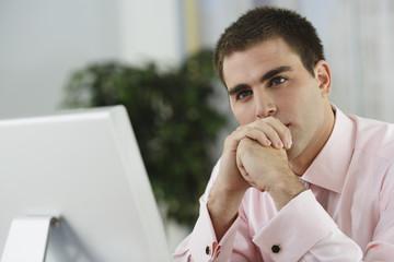 Middle Eastern businessman sitting at desk