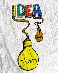 idea Light bulb icon on Cement wall texture background design