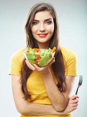 Woman diet concept portrait. Female model hold green salad.