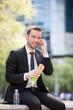 Businessman eating sandwich for lunch break