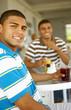 Hispanic men drinking at bar