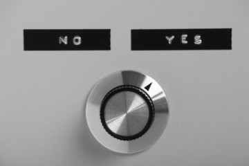 Control switch or knob pointing at the word Yes