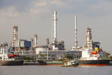 oil refinery and tanker ship on port in heavy industry use for e