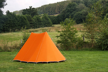 Campsite in the Belgian Ardennes with a orange canvas tent