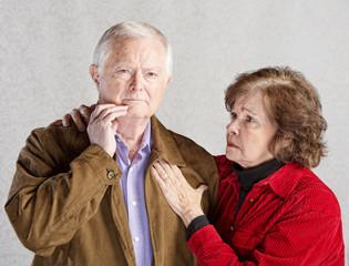 Worried Elderly Couple