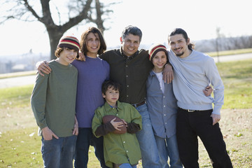 Portrait of Hispanic family at park