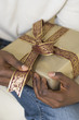 African man holding gift