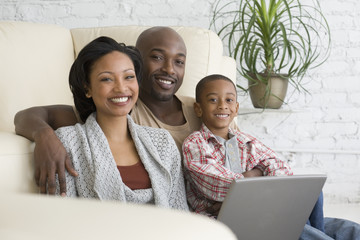 African family hugging on sofa