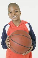 African boy holding basketball