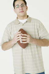 Middle Eastern man holding football