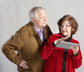 Nosey Man and Lady with Tablet