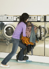Asian woman in laundromat