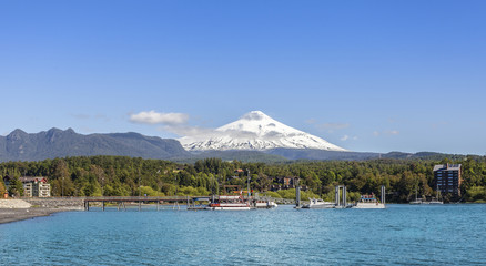 Lake in Pucon and snow covered Volcano Villarica, Chile.