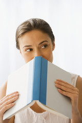 Woman holding open book