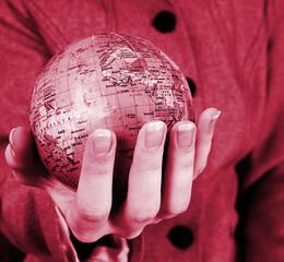 Globe in a girl's hands