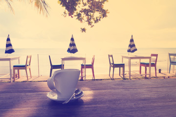 Afternoon coffee break by the beach in vintage style