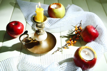 Composition with apples and candles