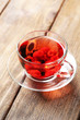 Fruit red tea with wild berries in glass cup,
