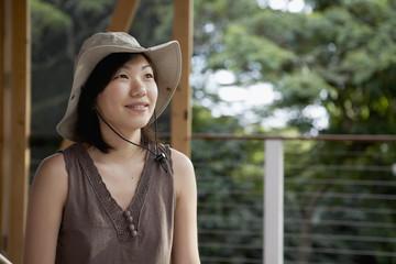Asian woman wearing safari hat