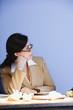 Hispanic businesswoman sitting at desk