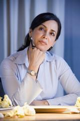 Hispanic businesswoman thinking