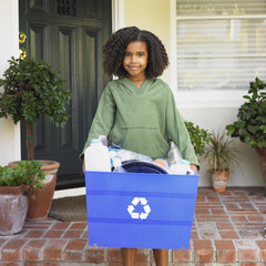 African girl holding recycling bin